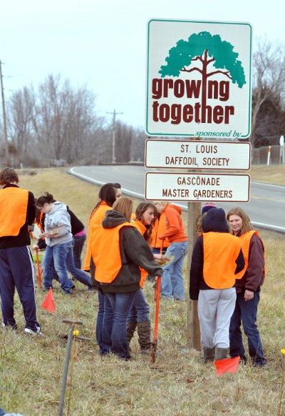 Growing Together Sign with Students